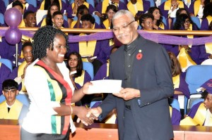 President David Granger presents a cheque for $1M to the Head Teacher of President's College, Ms. Carlyn Canterbury, for the development of the school's science and technology facilities.
