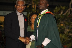 Kibwey Peterkin received the President's Medal from President David Granger for being best graduating Bachelor's Degree student from the Faculty of Health Sciences.