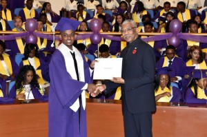 Valedictorian of the Class of 2016 of the President's College, Mr. Camroul Hookumchand receives the President's Award from President David Granger.