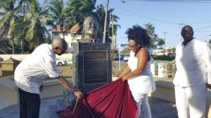 A bust in honour of late Georgetown Mayor and government minister, Claude Merriman was Saturday unveiled by President David Granger and Vanessa Merriman- Harding. At right is one of her siblings, Justice Courtney A. Abel. The bust is located at the eastern end of Merriman's Mall.
