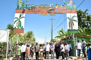 "President David Granger (centre), Ministers of the Government, regional officers and village officials at the ""First Village' Arch, which has been designed and mounted by the villagers."
