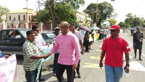 Opposition Leader, Bharrat Jagdeo greets a long line of PPP supporters protesting outside the Public Buildings⁠
