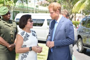 First Lady, Mrs Sandra Granger greets Prince Henry of Wales, familiarly known as Prince Harry upon his arrival at State House