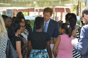 Prince Harry of Wales interacts with several of the young women who attended the reception